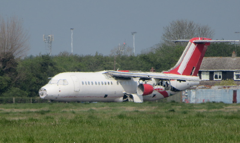 Withdrawn Air Libya Avro RJ 100 SA-FLA at Cranfield Airport having been stripped for parts, 16.04.2020.