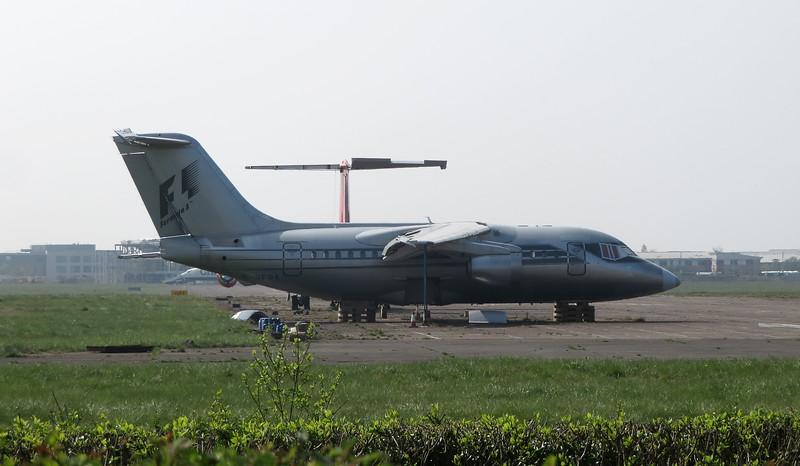 Withdrawn Formula 1 liveried Avro RJ 85 G-OFOA at Cranfield Airport, 16.04.2020.