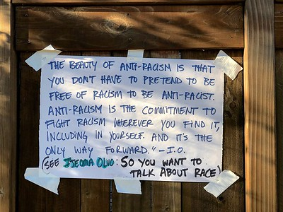 Sign on residential fence 6 8 20 by Nancy Ruin