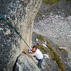 """Looking down on Peter as he follows the fourth pitch of """"Toto"""" (5.9)."""
