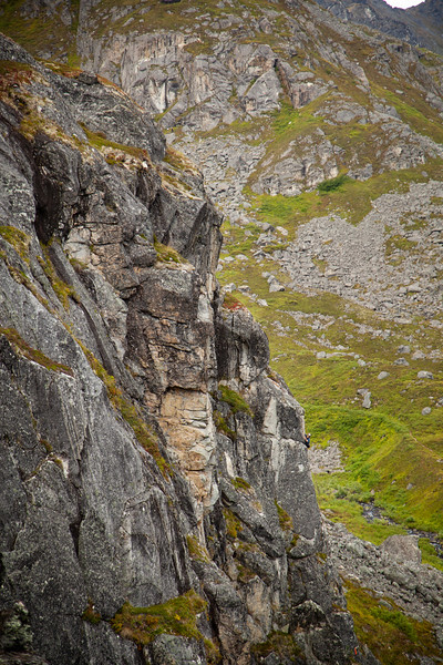 """A nearby climber works toward the top of """"Physical Attraction"""" (5.8) on the Zulu Wall."""