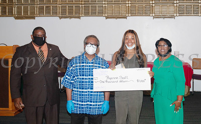 Deacon Jessie Ware and Deacon Floyd Lewis present Ryenne Scott, with a $1,000 check from the Marilyn E. Lewis Scholarship fund, along with Rev. Dr. Dollyann Newkirk-Briggs on Friday, August 14, 2020 at Baptist Temple Church in Newburgh, NY. HUDSON VALLEY PRESS/ Chuck Stewart, Jr.