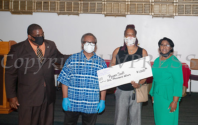 Deacon Jessie Ware and Deacon Floyd Lewis present Raven Scott (Dee Dee Russell-Scott, mother), with a $1,000 check from the Marilyn E. Lewis Scholarship fund, along with Rev. Dr. Dollyann Newkirk-Briggs on Friday, August 14, 2020 at Baptist Temple Church in Newburgh, NY. HUDSON VALLEY PRESS/ Chuck Stewart, Jr.