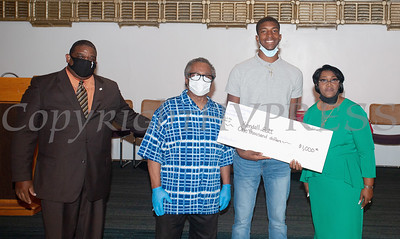 Deacon Jessie Ware and Deacon Floyd Lewis present Kendall Scott, with a $1,000 check from the Marilyn E. Lewis Scholarship fund, along with Rev. Dr. Dollyann Newkirk-Briggs on Friday, August 14, 2020 at Baptist Temple Church in Newburgh, NY. HUDSON VALLEY PRESS/ Chuck Stewart, Jr.