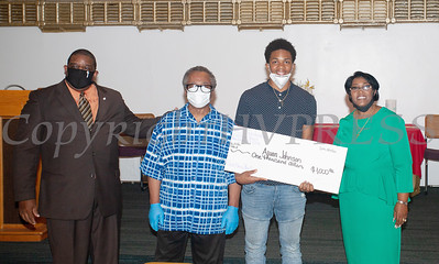 Deacon Jessie Ware and Deacon Floyd Lewis present Ajuan Johnson Scott, with a $1,000 check from the Marilyn E. Lewis Scholarship fund, along with Rev. Dr. Dollyann Newkirk-Briggs on Friday, August 14, 2020 at Baptist Temple Church in Newburgh, NY. HUDSON VALLEY PRESS/ Chuck Stewart, Jr.