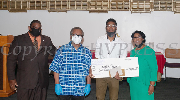 Deacon Jessie Ware and Deacon Floyd Lewis present Malik Powell, with a $1,000 check from the Marilyn E. Lewis Scholarship fund, along with Rev. Dr. Dollyann Newkirk-Briggs on Friday, August 14, 2020 at Baptist Temple Church in Newburgh, NY. HUDSON VALLEY PRESS/ Chuck Stewart, Jr.