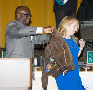 Glendon Fraser presents Heather Howley, Owner Operator of Independent Helicopter with a Tuskegee Airmen Jacket during the 22nd Annual Tuition Assistance Awards Celebration of the Major General Irene Trowell-Harris Chapter of the Tuskegee Airmen on Saturday, February 8, 2020 at Anthony's Pier 9 in New Windsor, NY. Hudson Valley Press/CHUCK STEWART, JR.
