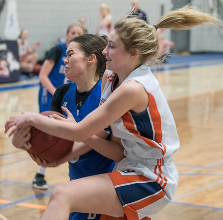 Wolves Abigail Davey (9) battles for the ball with Bandit Sydney Morris during a game between the Beaumont Composite High School Bandits (in blue) and Morinville Community High School Wolves (in white) at Morinville High School on Saturday Feb. 1, 2020.  John Lucas/St. Albert Gazette