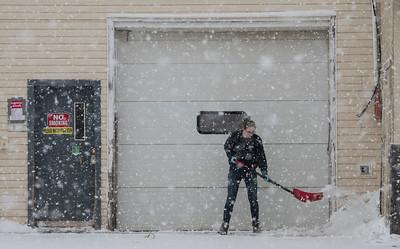 Falling snow kept Kimberly Sampson busy in front of the Morinville Bottle Depot in Morinville on Saturday Feb. 1, 2020.  John Lucas/St. Albert Gazette