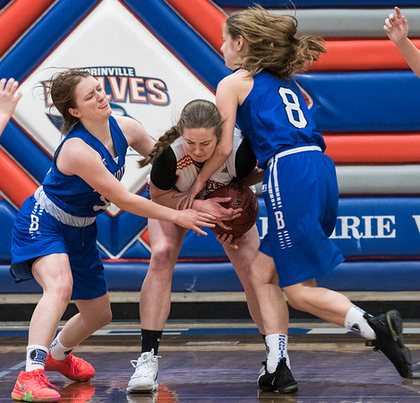 Wolves Jordan Hessell (15) battles for the ball with Bandits Allison Van Stone (left) and Camryn Munchrath (right) during a game between the Beaumont Composite High School Bandits (in blue) and Morinville Community High School Wolves (in white) at Morinville High School on Saturday Feb. 1, 2020.  John Lucas/St. Albert Gazette