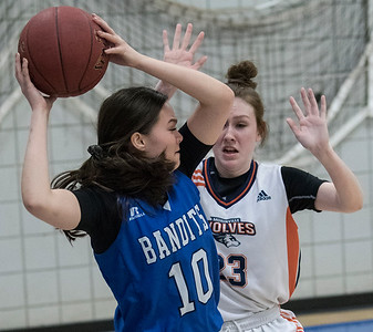Wolves Hayley Deveau (23) pressures Sydney Morris during a game between the Beaumont Composite High School Bandits (in blue) and Morinville Community High School Wolves (in white) at Morinville High School on Saturday Feb. 1, 2020.  John Lucas/St. Albert Gazette