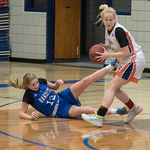 Bandit Olivia Pedersen got knocked down by Leanne Van Brabant during a game between the Beaumont Composite High School Bandits (in blue) and Morinville Community High School Wolves (in white) at Morinville High School on Saturday Feb. 1, 2020.  John Lucas/St. Albert Gazette