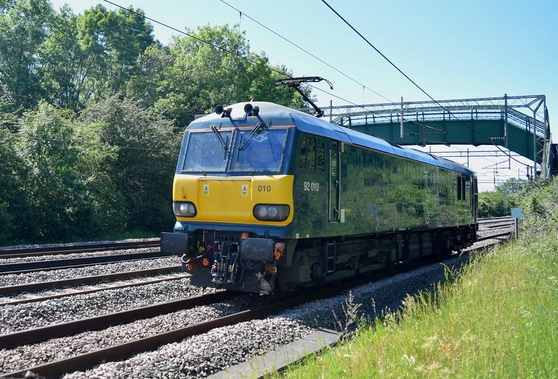 GBRf / Caledonian Sleeper Class 92 no. 92010 passing Bradwell, Milton Keynes, on a Crewe-Wembley light engine move. 02.06.2020.