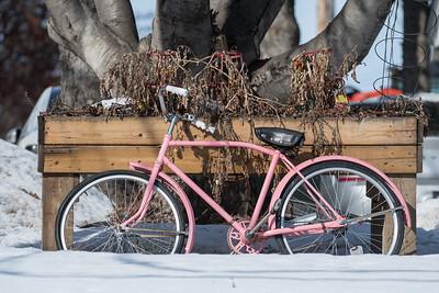 A pink bike sits in the snow downtown in St. Albert on Sunday Mar. 1, 2020. (JOHN LUCAS/St Albert Gazette)