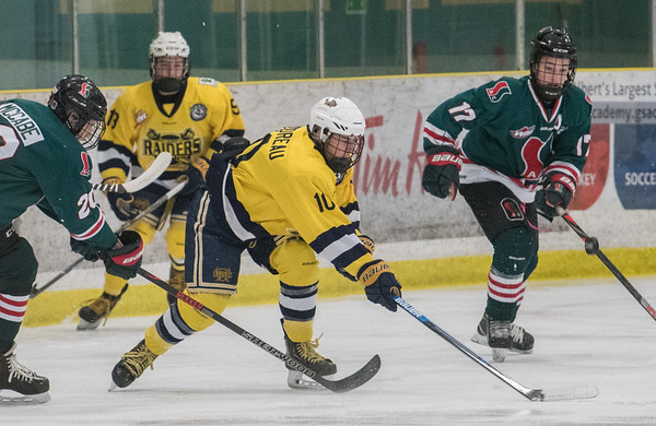Sabre Jacob Goudreau splits the defense during a playoff game between the St. Albert Gregg Distributors Sabres (in yellow) and SSAC Lions (in green) at Jarome Iginla Arena in St. Albert on Sunday Mar. 1, 2020. (JOHN LUCAS/St Albert Gazette)
