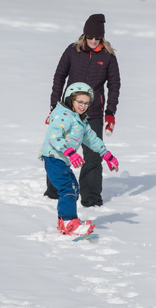 7 year old Isla Hudson tries out her snow board with her mom Nikki Lawton on the Seven Hills in St. Albert on Sunday Mar. 1, 2020. .(JOHN LUCAS/St Albert Gazette)