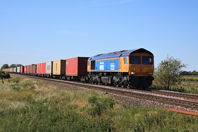 66731 'Capt. Tom Moore, A True British Inspiration' passing Wisbech Road crossing, Manea at 1630/4z81 Masborough to Felixstowe