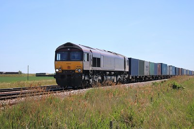 66746 passing Wisbech Road crossing, Manea at 1218/4M29 Felixstowe to Birch Coppice