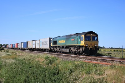66534 passing Wisbech Road crossing, Manea at 1601/4L87 Leeds to Felixstowe