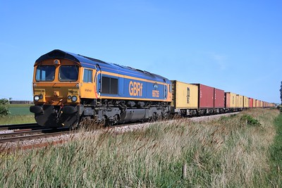 66735 passing Wisbech Road crossing, Manea at 1555/4E20 Felixstowe to Masborough