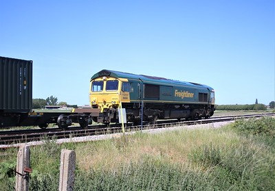 66506 passing Wisbech Road crossing, Manea at 1051/4M81 Felixstowe to Crewe Basford Hall
