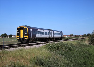 158773 passing Wisbech Road crossing, Manea at 1008/1R74 Norwich to Liverpool