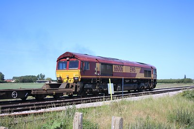 66006 passing Wisbech Road crossing, Manea at 1043/4M79 Felixstowe to East Midlands Gateway