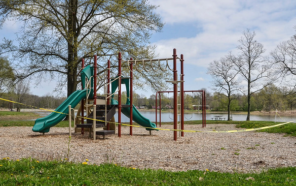 Tribune-Star/Austen Leake<br /> Spoiled sunny day: Even when the weather is warm and the sun is shining, playgrounds sit empty, like this one in Fowler Park.