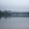 Tribune-Star/Austen Leake<br /> Still on the road: A truck crosses the Wabash River bridge on a foggy morning.