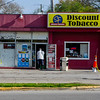 Tribune-Star/Austen Leake<br /> Tobacco shops and liquor stores, which have remained open, have been moved to a system where customers wait outside.