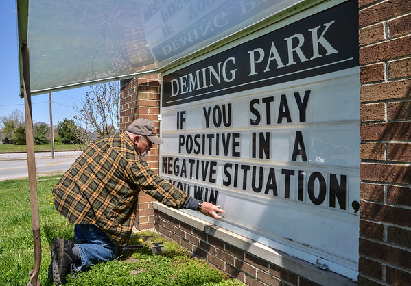 Tribune-Star/Austen Leake<br /> Positive message: Wayne Hamilton, a Terre Haute Parks Dept. employee, spells out a postive message in the sign at the corner of Fruitridge Avenue and Poplar Street on April, 28.