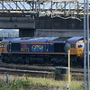 """GBRf pride branded Class 66 no. 66773 """"Pride of GB Railfreight"""" at Bletchley on the Cemex stone train, 03.11.2020."""