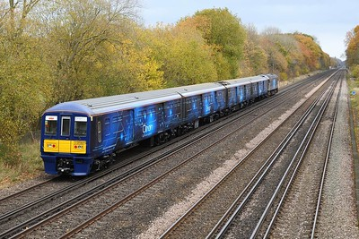 17 November 2020 :: Orion 319 373 in ROG livery working 5Q71 from Eastleigh to Wembley is seen passing Old Basing.  The unit has been converted to carry parcels traffic and also carrys a Royal Mail logo above the driving cab