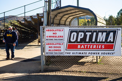 Optima Batteries banner as race fans pass by