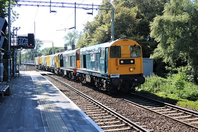 On hire to LORAM, 20205_20007 pass Roydon at 1635/6X20 Romford Engineers Sidings to Derby RTC with Milling machine DR79601