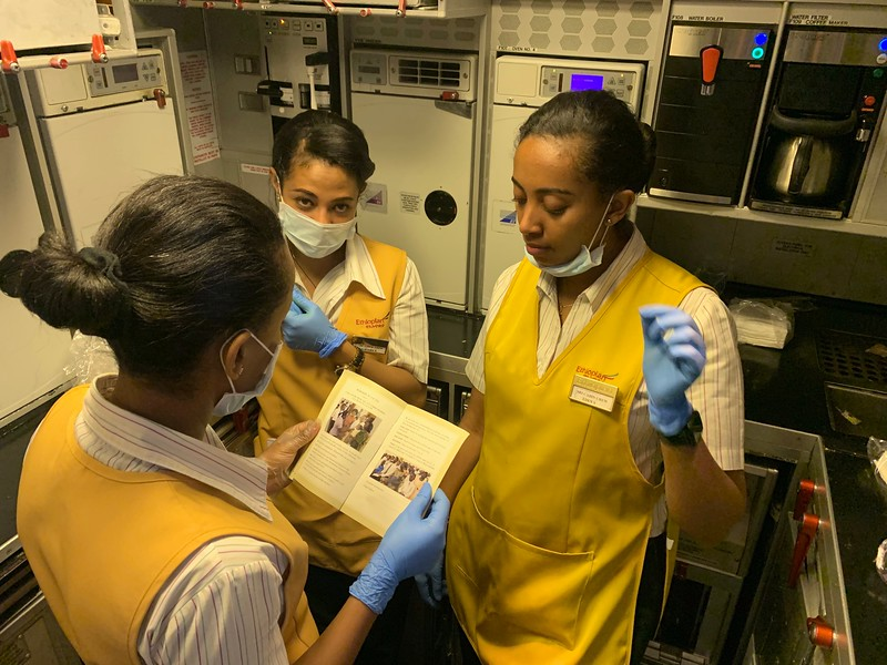 Flight Crew reading Restoration Pamphlet after a discussion given by 2 Elders