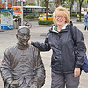 Anne with a statue on the streets of Taipei