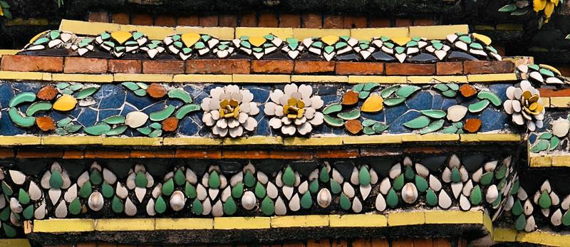 Ceramic flowers detail buildings of Wat Pho