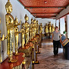 Anne with Buddha statues as Wat Pho