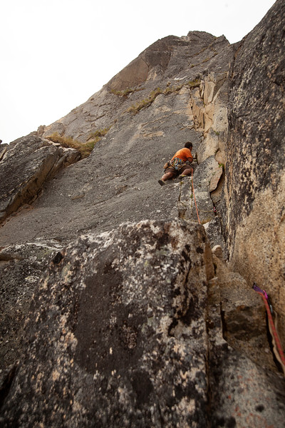 Kelsey working pitch 2 of <i>Rampart Rampage 5.10c</i>.