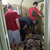 Warrior Men's Basketball team working with FaithWorks broke up concrete floor, mixed and laid new concrete for bathrooms at Dutton Farm. August 2021