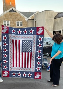 Ann Newell designed, pieced and quilted this beautiful QOV for a family member.