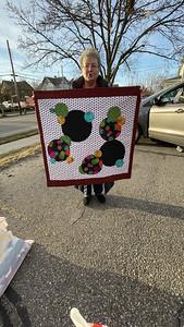 Jean Kaufmann holding a Heartwarmers donation quilt