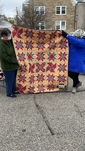 Chelane Priller showing a saw-tooth star quilt.