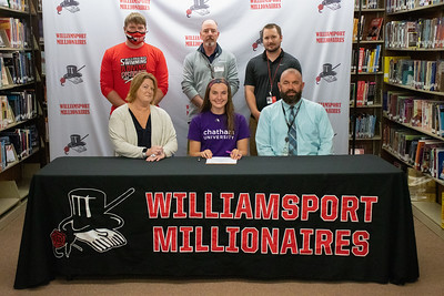 Isabelle Griswold, center, signs with Chatham University for swimming and softball in the company of swimming coaches, Brett Johnson and Jeff Beattie, softball coach Chase Smith, and parents Marci and Glenn Griswold.