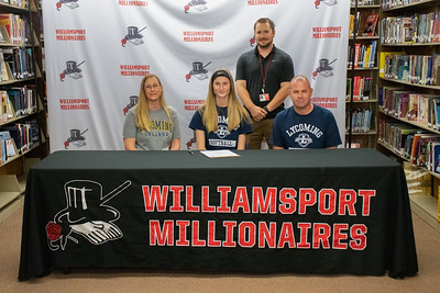 Avery Eiswerth, center, signs to play softball at Lycoming College in the company of her parents, Jason and Bobbi Jo, sitting, and Coach Chase Smith.