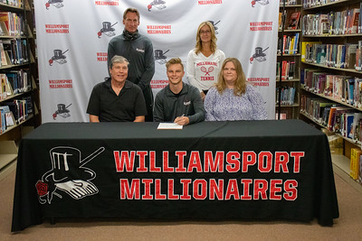 Alex Norris, center, signs with Pennsylvania College of Technology to play tennis, in the company of his parents, Frank and Cindy, and coaches John Dorner and Karen Hooker, standing.