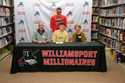 Jack Beattie, center, signs with Clarion University for diving in the company of Coach Brett Johnson and parents, Jeff and Krista Beattie.