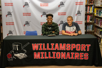 Max Goode sits with Coach Jeremy Steppe as he signs his letter of intent to do track and field at Point Park University.