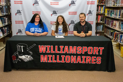 Hailey DeBrody signs with Pennsylvania College of Technology to play softball in the company of her mother, Sheena Utter, and Coach Chase Smith.